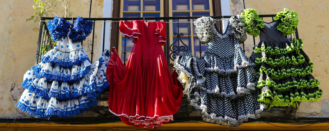 Flamenco Dresses on Display from a Porch