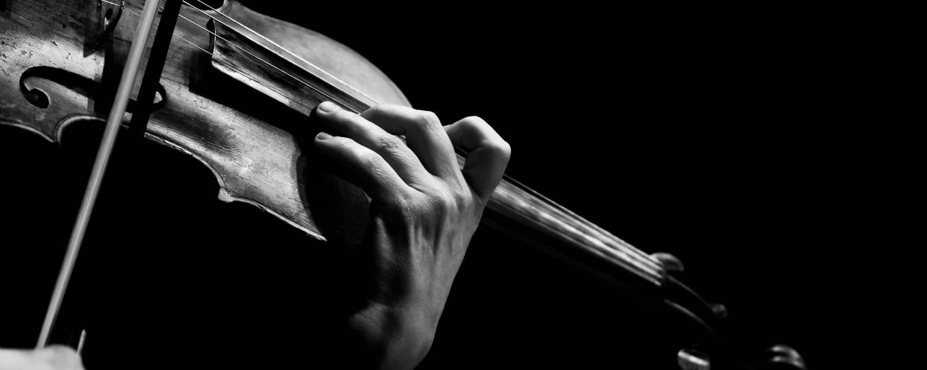 Black and White of a Violin Being Played
