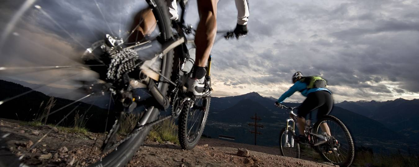 Close-up of Two Mountain Bikers Riding
