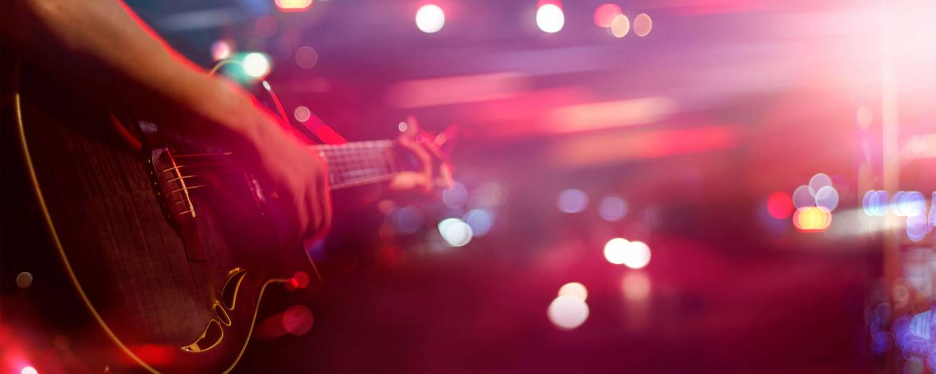 Guitar Player On Stage with Colorful Lights