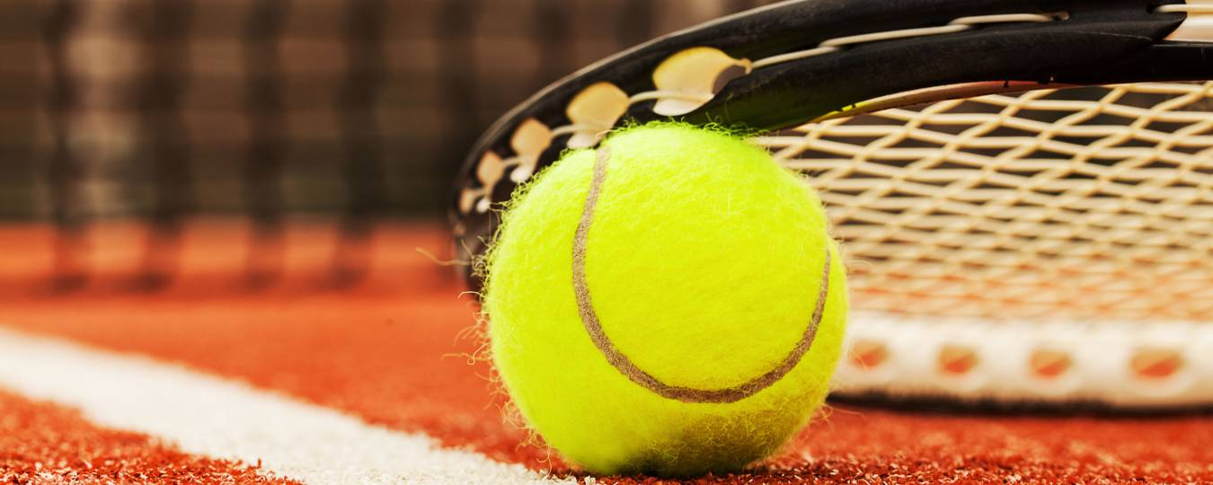 Close-up of a Tennis Ball and Racket on a Tennis Court