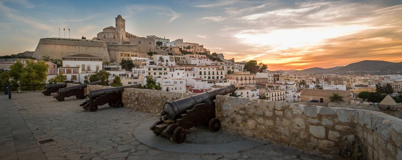 Dalt Vila Fortress at Sunset with Cannons