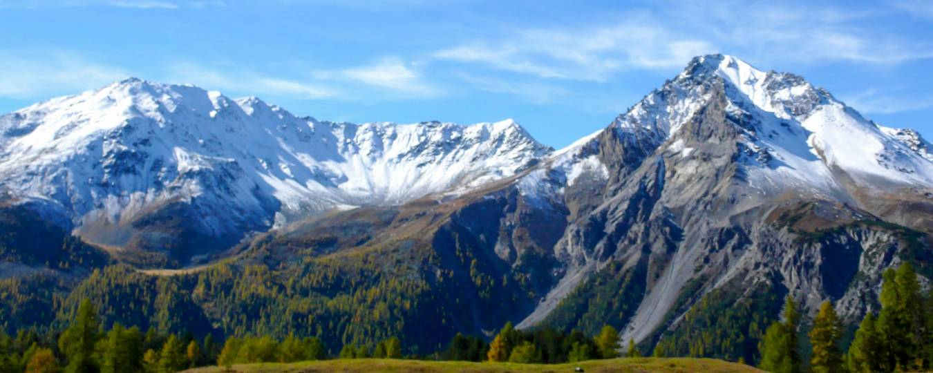Swiss Mountain Range with Clouds and Blue Skies
