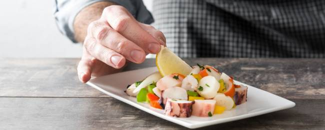 Chef crafting fresh ceviche dish in Tulum, Mexico.