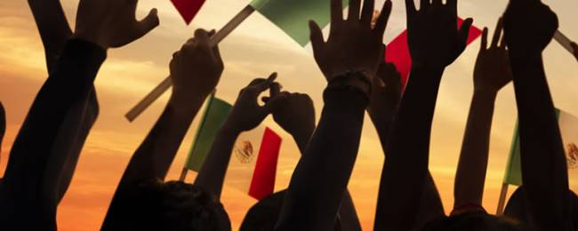 Hands and Mexican Flags