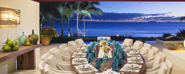 Dining area and deck with oceanfront view