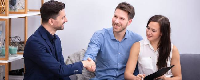 Couple consulting with property manager