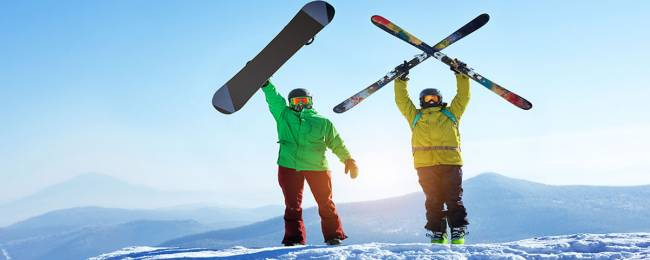 Two strong, healthy skiers standing on top of mountain in Telluride.