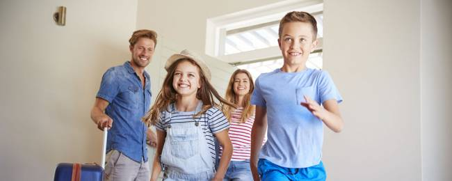 Family going into luxury vacation rental