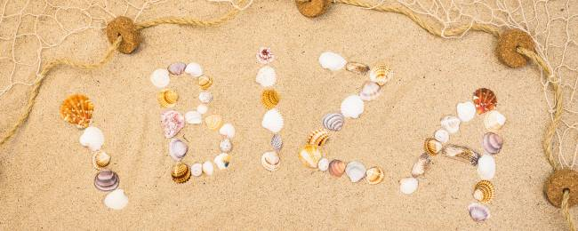 Ibiza Written with Shells in the Sand