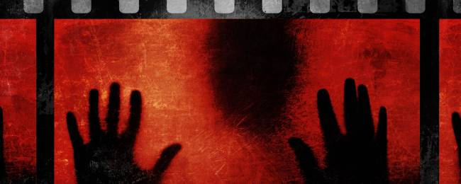 Creepy Black Silhouette with Red Background on a Film Strip
