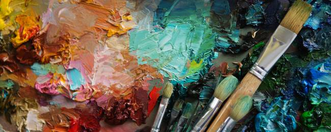 An artist's palette with a variety of colors and brushes.