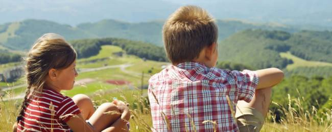 Boy and Girl Sitting Looking At View