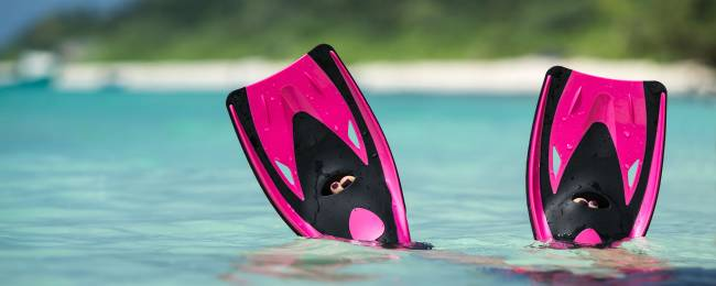 Snorkeler Fins Floating in the Water