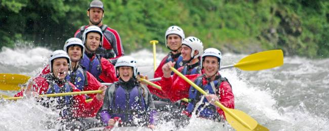 A group rafting down a river having fun in Colorado.