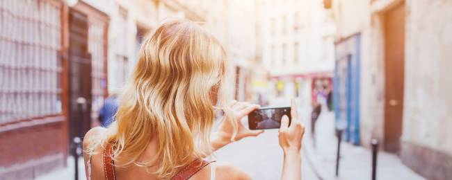 Woman Taking a Picture of Spanish Street