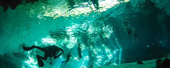 Divers in a Cenote