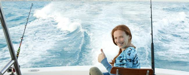 Happy Woman on a Fishing Charter Boat