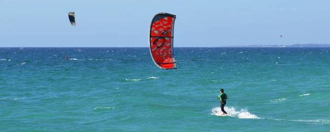 Kitesurfers out in the water