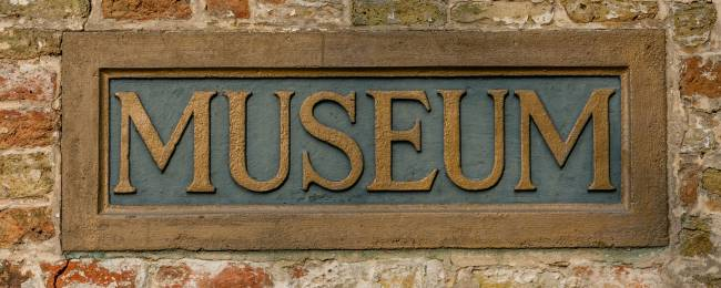 Museum Sign on Brick