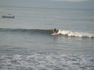 surfing on a right in punta mita