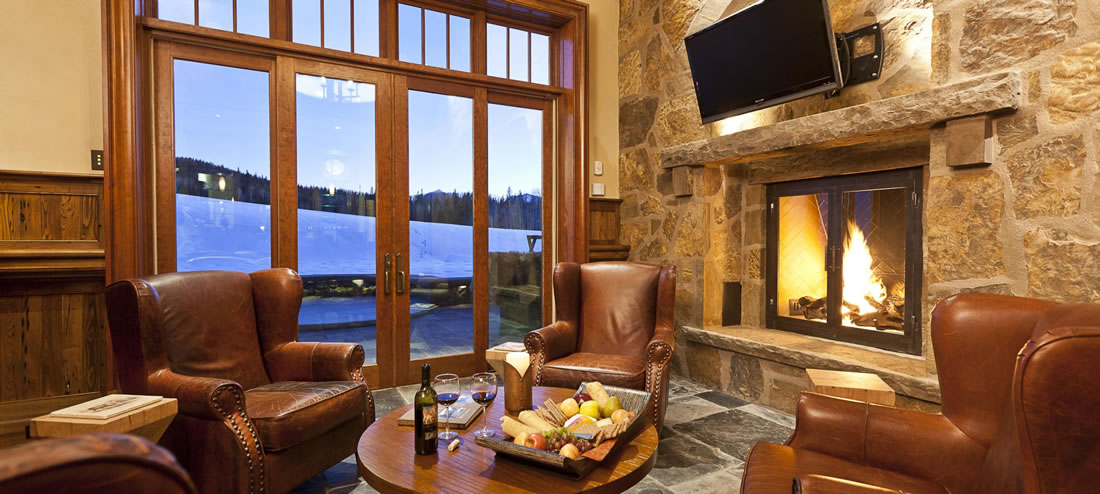 Hoodpark Manor luxury rental living area with fireplace and mountain view in Telluride.