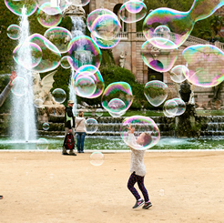 Little Girl Playing with Bubbles in Ciutadella Park, Barcelona