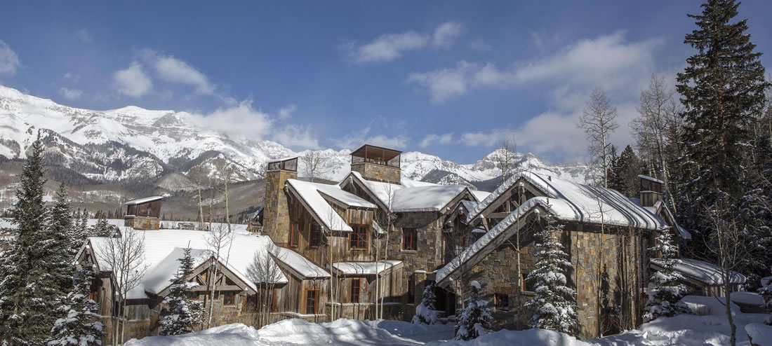 Knightsbridge luxury rental exterior view with snowy mountains in Telluride.