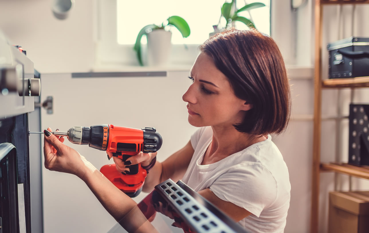 Female property owner making repairs for renters