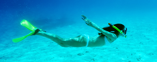 Woman snorkeling underwater in Ibiza