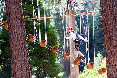 Kid on a Treetop adventure in Costa Brava