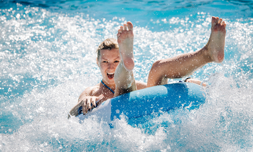 Woman inner tubing at a water park