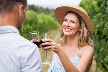 Couple Toasting with Wine Glasses in a Vineyard